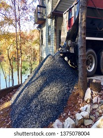 Dump truck delivering gravel to a job site.