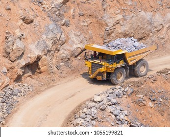 Dump truck  in limestone mining, heavy machinery.