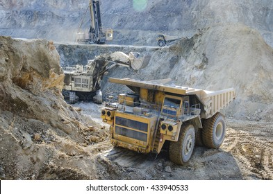 Dump truck in the open pit mine
