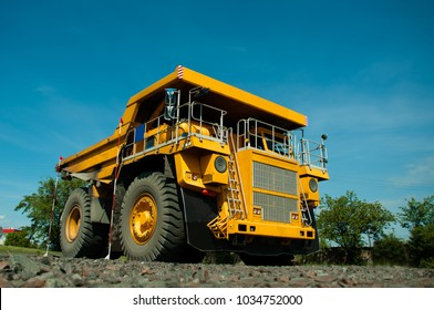 A dump truck parked in the background of the workshop. Exam on driving.
