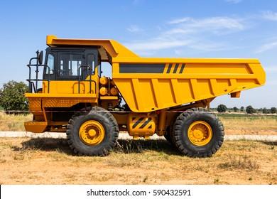 Dump truck parking big yellow transporter