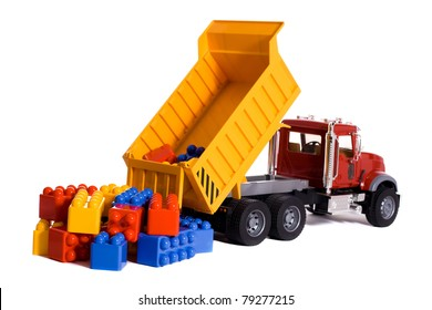 Dump truck toy downloading colorful blocks isolated on white