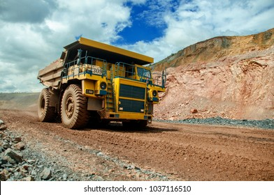 the dump truck transports iron ore. Colorful quarry.