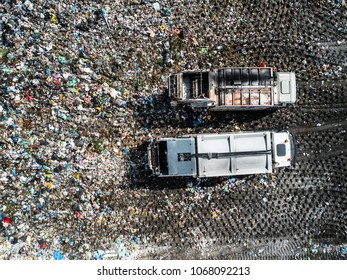 Dump truck unloading waste on a landfill