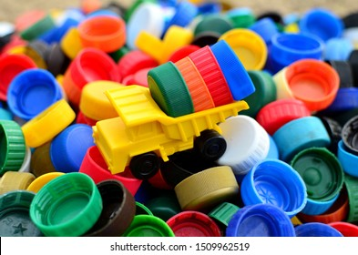Dump truck unloads colorful plastic caps.  Concept for the collection, recycling of plastic bottle caps