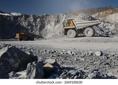 Dump-body truck in the open-cast mine. Mining equipment. Quarry equipment.