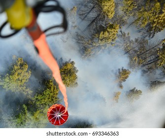 Dumping water onto a forest fire.