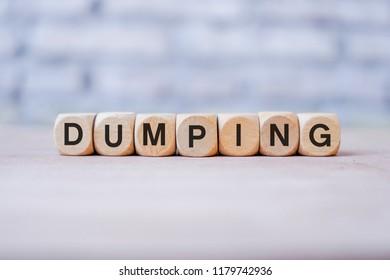 Dumping word written on wood block