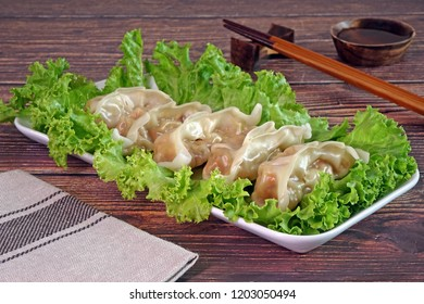 Dumpling : Chinese / Japanese dumplings, delicious traditional asian food. Japanese dumpling or Gyoza, Chinese dumpings or Jiaozi