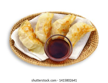 Dumpling pot stickers chinese style Shrimp Juicy fried gyoza with fish sauce in glass bowl isolated on white background. This has clipping path.