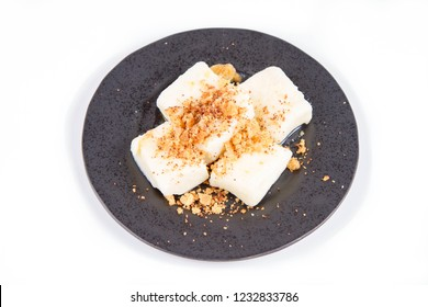 Dumplings with cottage cheese (traditional polish dish called lazy pierogi/ leniwe pierogi) fried with bread crumbs