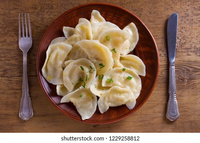 Dumplings, filled with mashed potato. Varenyky, vareniki, pierogi, pyrohy - dumplings with filling, popular dish in many countries. View from above, top studio shot