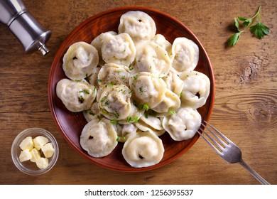 Dumplings, filled with meat, ravioli, pelmeni. Dumplings with filling. overhead, horizontal