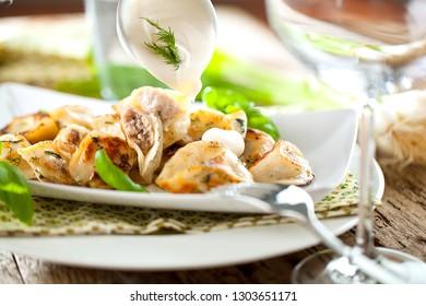 Dumplings, filled with meat, ravioli. Traditional Russian dish pelmeni. Dumplings with filling horizontal