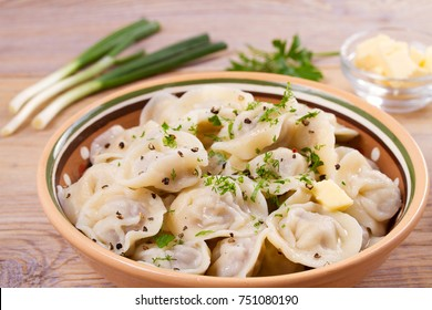 Dumplings, filled with meat, ravioli. Traditional Russian dish pelmeni. Dumplings with filling horizontal