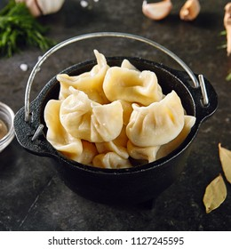 Dumplings Jiaozi, Dimsum, Momo or Ha Gao on Dark Background. Asian Food of Dough Based on Flour Stuffed with Meat, Fish, Vegetables, or Sweets