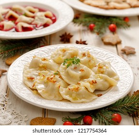 Dumplings with mushroom cabbage filling on a white plate. Vegetarian food, Traditional Christmas eve dish in Poland