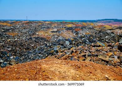 Dumps of depleted ore