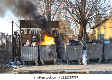Dumpster Fire With Heavy Smoke Pollution From Garbage