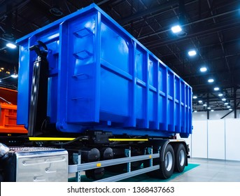 Dumpster on the car. Garbage removal. Dump semitrailer. Trailed equipment. Trucks. Special machinery.  Dump truck transportation of bulk cargo. Freight transport industry.