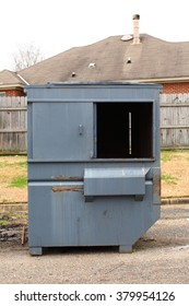 Dumpster Outside Garbage Can in Front of House Neighborhood