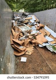 Dumpster with remodeling debris