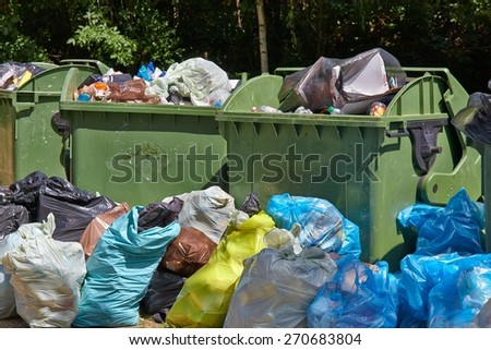 Dumpsters being full with garbage