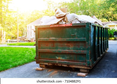 Dumpsters being full with garbage in a city. Dumpsters being full with garbage