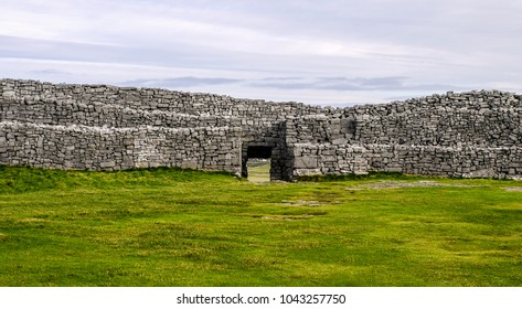 Dun Aengus Fort on the Aran Islands, Ireland. Dry stone, ancient fortification on Inis More on a cloudy day.