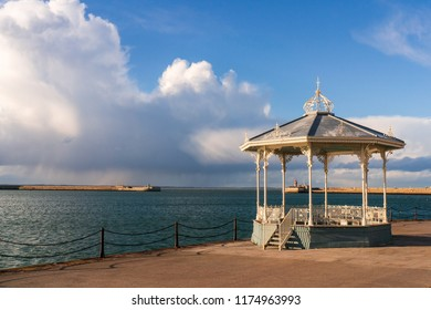 The Dun Laoghaire bandstand landmark located on the East pier of the harbour in Dublin, Ireland. Victorian cast iron filigree bandstand.