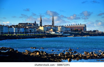 DUN LAOGHAIRE, IRELAND - FEBRUARY 5: Bright sunshine illuminates the seafront promenade of Dun Laoghaire town on February 5, 2017 in Dublin, Ireland.