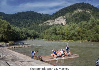 DUNAJEC, POLAND-SEP 29, 2018: Traditional rafting on the Dunajec River on wooden boats. Boats are served by highlanders from Pieniny in traditional costumes.