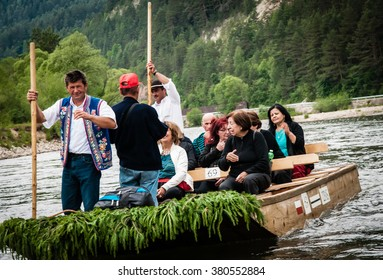 DUNAJEC RIVER, POLAND - JUNE 26, 2015: Tourists raft on the Dunajec river, south of Poland. The rafting near the slovakian border is very popular tourist attraction.