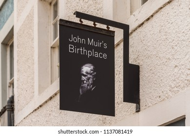 "DUNBAR, SCOTLAND - JULY 17, 2018: Sign at the entrance of the John Muir birthplace building in Dunbar, Scotland.  John Muir was known as ""Father of the National Parks"" in the USA."