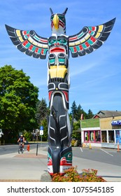 "DUNCAN BC CANADA JUNE 22 2015: Totem pole in Duncan's tourism slogan is ""The City of Totems"". The city has 80 totem poles around the entire town, which were erected in the late 1980s."