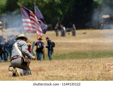 Duncan Mills, CA - July 14, 2018: Confederate soldier being shot by union army the battlefield of. the Civil War Days. This is one of the largest reenactment events on the West Coast.