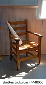 Dunce's Chair - old schoolhouse dunce cap chair in dramatic lighting - dust and grit cover everything