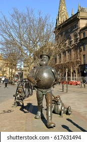DUNDEE, SCOTLAND - 27 MARCH 2017: Characters from the Dandy comic, Desperate Dan, with dog Dawg, and, behind, from the Beano, Minnie the Minx commemorated in city centre statues.