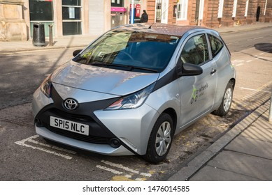 Dundee, UK - March 08, 2018: Co-wheels car club low emission city car parked in its bay in meadowside. Co-wheels is a pay-as-you-go car hire scheme, with vehicles available in locations across the UK.