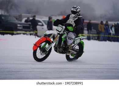 Dundee, Wisconsin USA - January 22nd, 2021: 3 hour steel shoe dirt bike competition ice race took place on kettle moraine lake