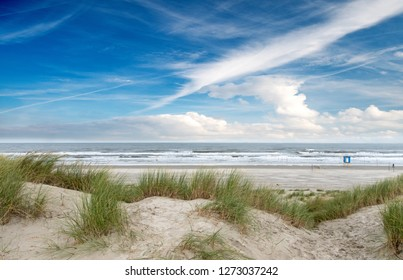 Dune beach on the North Sea island Langeoog in Germany with clouds on a beautiful summer day