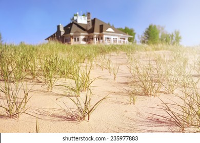 Dune grasses with beach house  in the distance