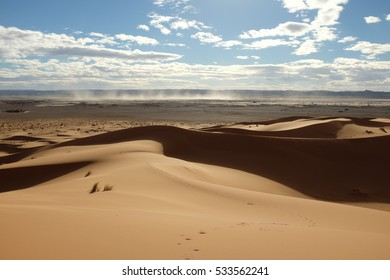 Dune Landscape of Sahara Desert with Dust Storm in the Distance