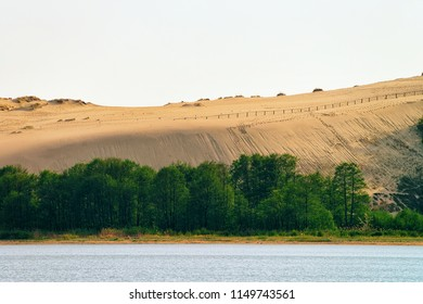 Dune in Nida town near Klaipeda in Neringa at the Curonian Spit and the Baltic Sea in Lithuania.