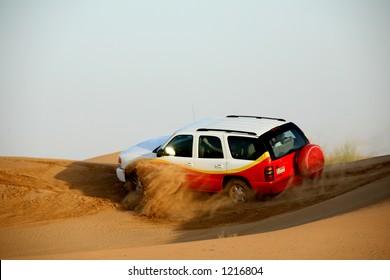 Dune riding in desert outside of Dubai