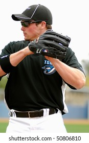 DUNEDIN, FL - MARCH 22: Toronto Blue Jays outfielder Travis Snider throws the ball prior to the spring training game on March 22, 2010 in Dunedin, FL .