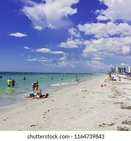 Dunedin, FL/USA - August 25, 2018: Beachgoers enjoy one of Florida's Gulf Coast beaches that is not suffering from red tide.