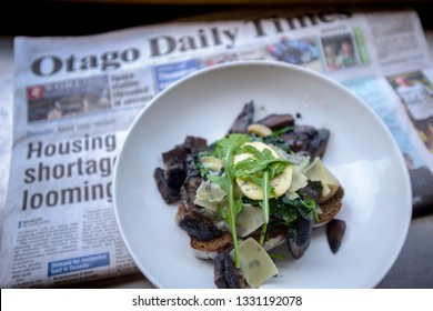 Dunedin , New Zealand, Feb 10th, 2019: Mushroom brunch at Dunedin, Otago. Background is Newspaper