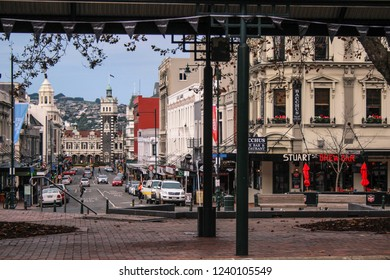 Dunedin, New Zealand - June 21, 2016: view over Dunedin city centre from The Octagon, Dunedin Railway Station and suburbs in the background