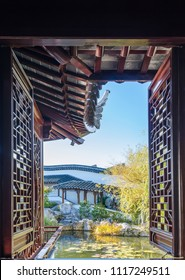 Dunedin,New Zealand - May 3,2016 : Beautiful scenic view can seen through the window in The Dunedin Chinese Garden in New Zealand.